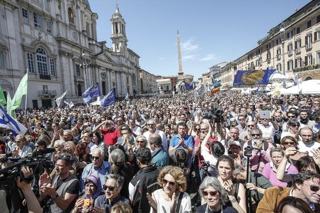 People attend the final farewell to the founder of the Radical Party, Marco Pannella, during a public ceremony in Rome's central Navona Square, Italy, 21 May 2016. Marco Pannella, the longtime firebrand leader of the Radical Party who waged a thousand civil-rights battles including landmark campaigns to legalise abortion and divorce, died on 19 May, aged 86, after a battle with cancer. ANSA/ GIUSEPPE LAMI